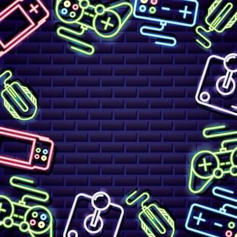 Controles de videojuegos enmarcados en estilo neón en pared de ladrillo