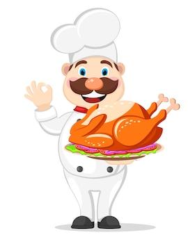 Cook sostiene un pavo asado en una bandeja y muestra la clase sobre un fondo blanco. día de gracias.