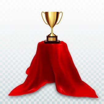 Copa trofeo dorado sobre pedestal con tela roja