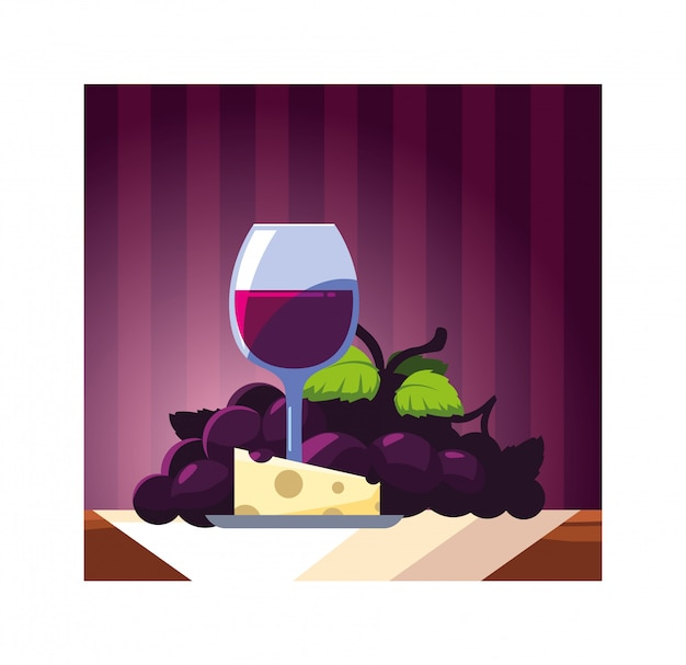 Copa de vino con uvas y porción de queso