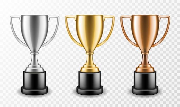 Copas de los ganadores de oro, plata y bronce