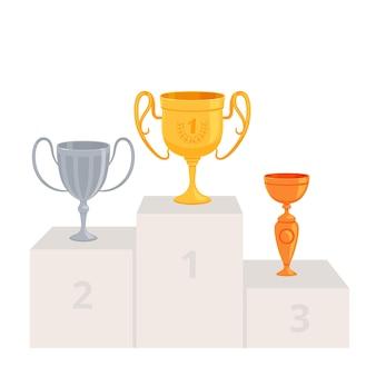 Copas de oro, plata y bronce sobre pedestal.