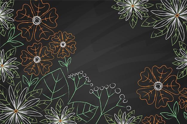 Copiar flores de espacio en el fondo de la pizarra