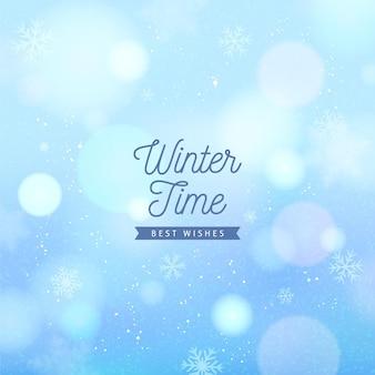 Copos de nieve borrosos con texto de invierno