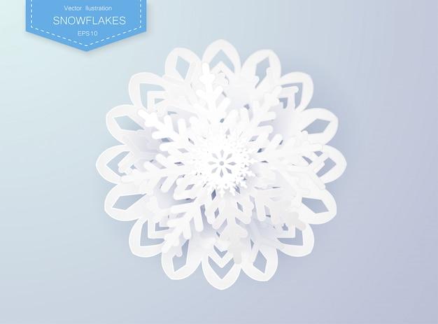 Los copos de nieve diseñan para el invierno con el espacio del texto del lugar. resumen papel artesanal copos de nieve