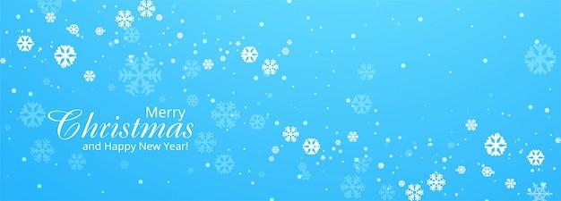 Copos de nieve feliz navidad tarjeta banner azul