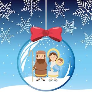 Los copos de nieve de josé y maría con jesús dentro de la bola de cristal