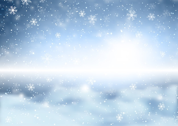 Copos de nieve de navidad sobre un fondo de paisaje invernal desenfocado