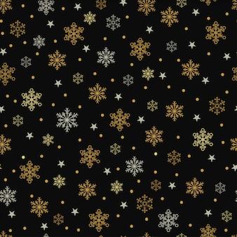 Copos de nieve de oro y plata y estrellas de patrones sin fisuras sobre un fondo negro