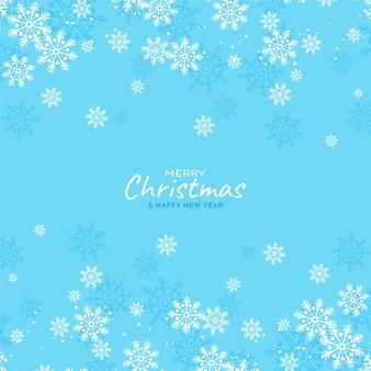 Los copos de nieve que fluyen feliz navidad fondo azul suave
