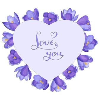 Corazón con azafranes de primavera dibujados a mano y el texto te amo, marco, aislado.