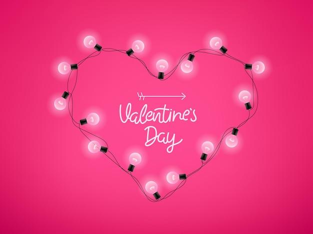 Corazón brillante e inscripción de letras sobre fondo rosa. día de san valentín