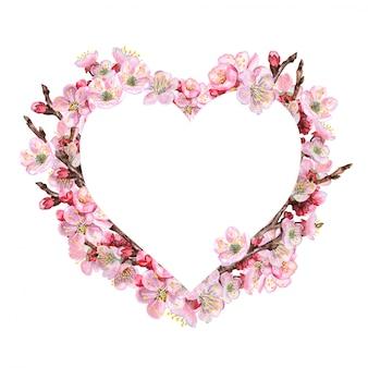 Corazón con ramas rosas florecientes