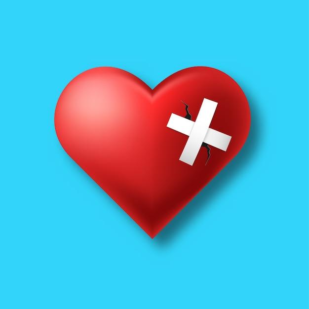 Corazón roto aislado sobre fondo azul.