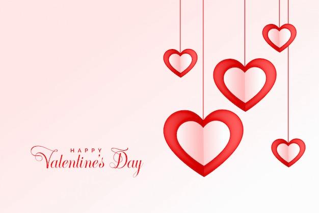 Corazones colgantes encantadores feliz día de san valentín fondo