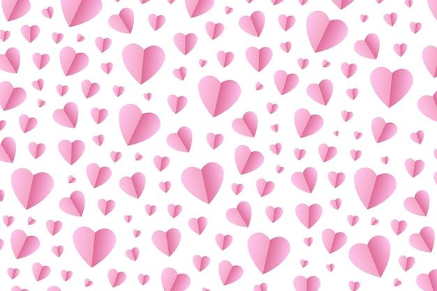 Corazones de origami rosa realista para decoración y revestimiento sobre el fondo blanco.