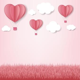 Corazones de papel con fondo rosa nube