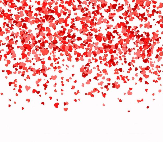 Corazones rojos y rosados cayendo del cielo