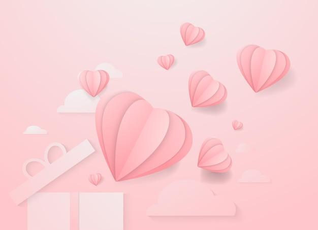 Corazones de san valentín con caja de regalo elementos voladores de papel postal sobre fondo rosa símbolos vectoriales ...
