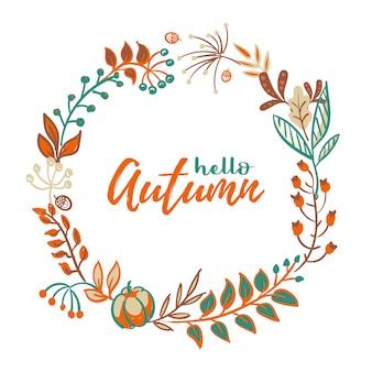 Corona de hojas de otoño y frutas en estilo doodle.