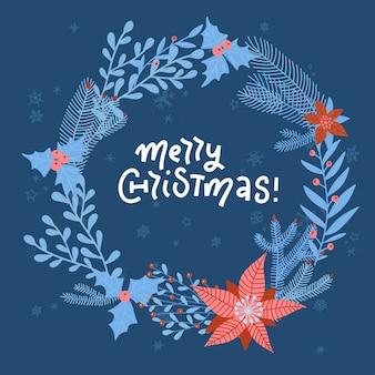 Corona de navidad con flores, ramas, hojas y copos de nieve sobre fondo azul oscuro. perfecto para tarjetas de felicitación navideñas.