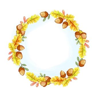 Una corona de otoño amarillo hojas de roble y bellotas.