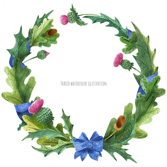 Coronas de cardo y hojas de roble con lazo de seda azul.