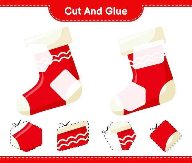 Corta y pega, corta partes de calcetín navideño y pégalas. juego educativo para niños, hoja de trabajo imprimible