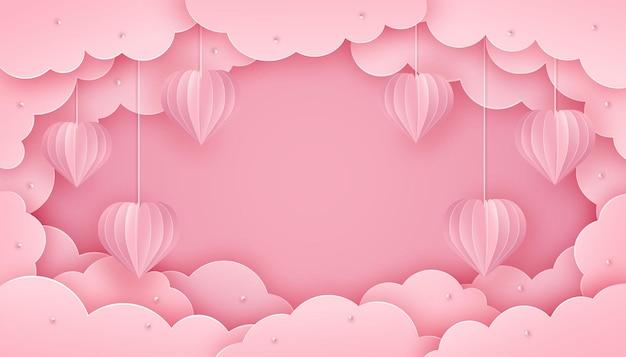 Cortar corazones 3d de papel colgando de cadenas sobre un fondo rosa