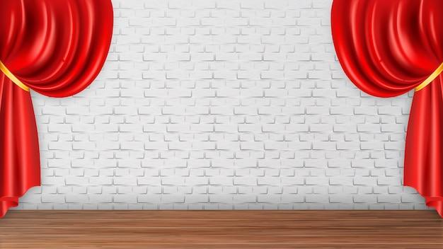 Cortinas rojas en la pared de ladrillo blanco