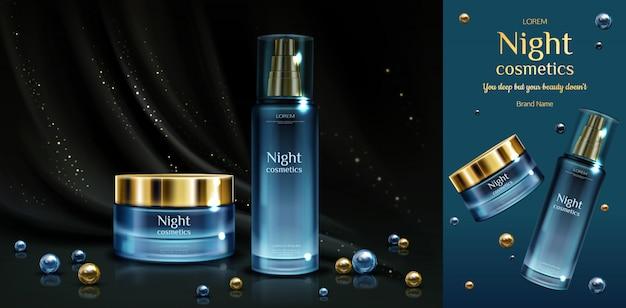 Cosméticos de noche, crema de belleza y frascos de suero sobre tela drapeada negra con destellos dorados y perlas.