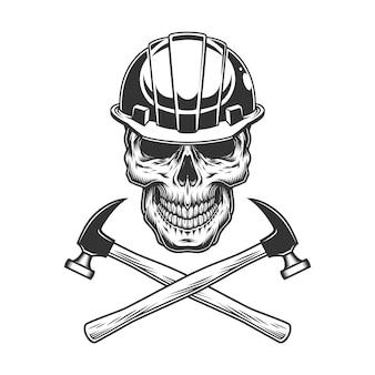 Cráneo de constructor vintage con martillos cruzados