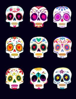 Cráneos decorativos coloridos establecen el día de los muertos