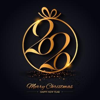 Creativa navidad y feliz año nuevo con una bola de oro.