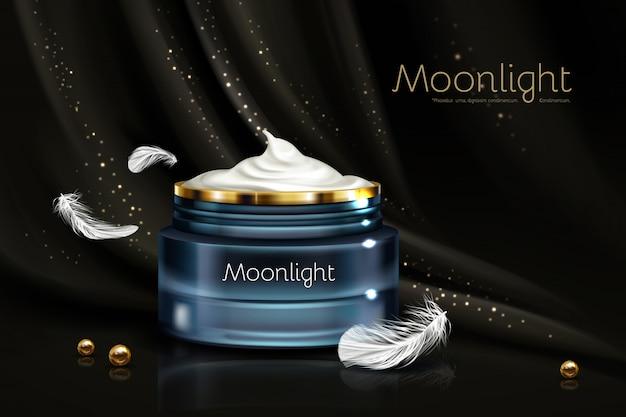 Crema hidratante nocturna en vidrio azul.