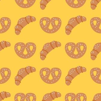 Croissants y pretzels sobre fondo amarillo, patrón transparente de vector