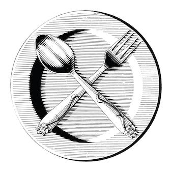 Cruz de cuchara y tenedor en el plato dibujar a mano estilo de grabado vintage imágenes prediseñadas en blanco y negro aislado sobre fondo blanco.