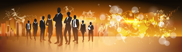 Crypto currency concept silhouette business people group standing over world map con bitcoin digita