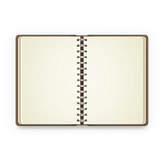 Cuaderno abierto con páginas en blanco.