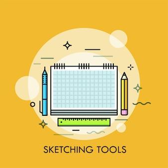 Cuaderno de bocetos de papel, bolígrafo, lápiz y regla.