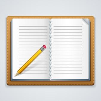 Cuaderno y lápiz sobre un fondo blanco.
