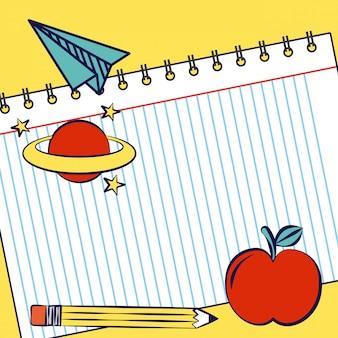 Cuaderno con manzana, planeta, lápiz y útiles escolares.