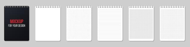 Cuadernos forrados y puntos de papel en blanco.