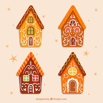 Cuatro altas casitas de jengibre decoradas