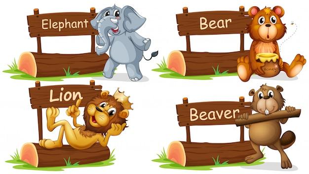 Cuatro animales salvajes con cartel de madera.