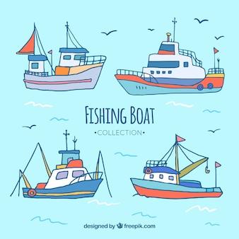 Cuatro barcos pesqueros dibujados a mano