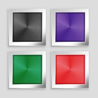 Cuatro botones metálicos cepillados en diferentes colores.