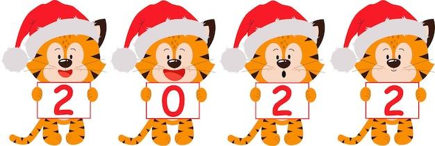Cuatro cachorros de tigre con carteles el año es 2022