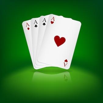 Cuatro cartas de juego de los as en fondo verde.
