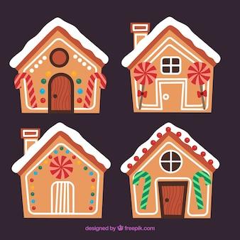 Cuatro casitas de jengibre decoradas con piruletas